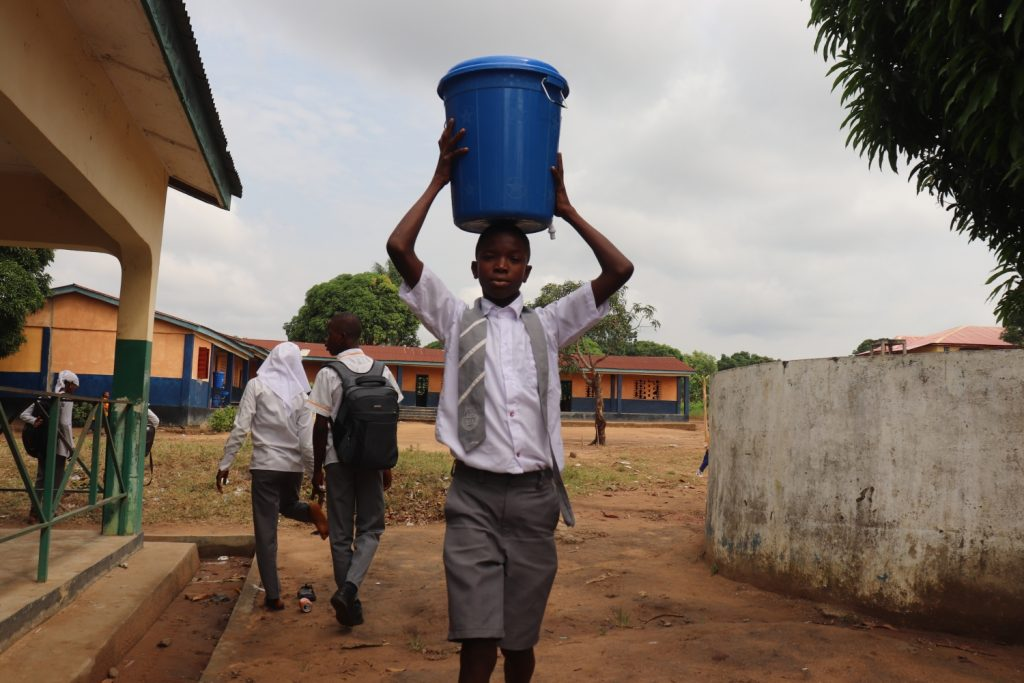 The Water Project : sierraleone21510-student-carrying-water-1
