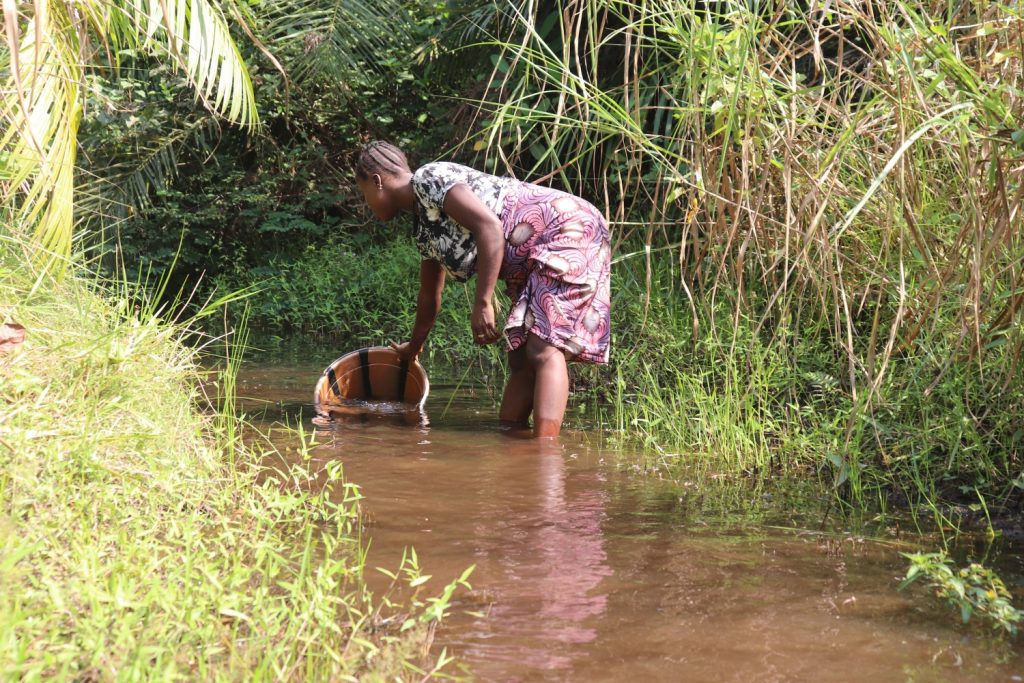 The Water Project : sierraleone21519-community-member-collecting-water-1