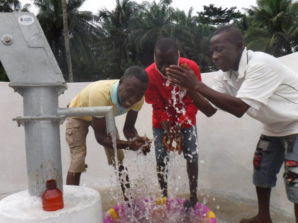 The Water Project : sierraleone20415-community-members-celebrating-clean-water-1