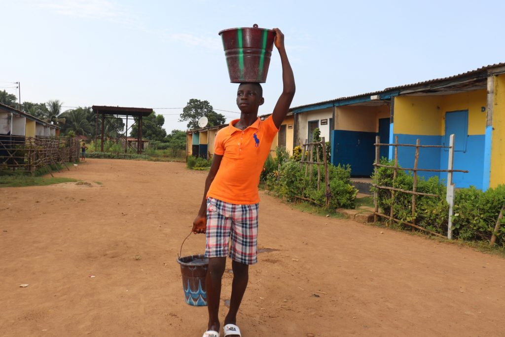 The Water Project : sierraleone21501-boy-carrying-water