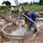 The Water Project: Kaitabahuma I Community -  Casing The Apron Of The Well