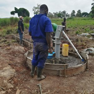 The Water Project:  Finishing The Concrete Work On The Well