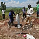 The Water Project: Kaitabahuma I Community -  Installing The Pump