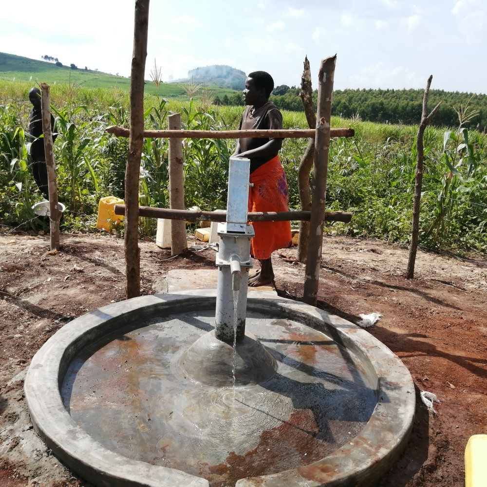 The Water Project : uganda20500-pumping-the-new-well
