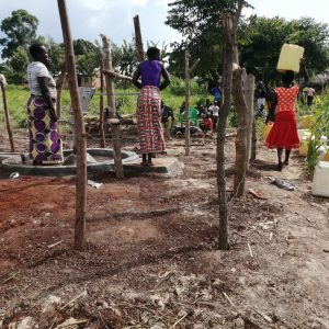 The Water Project:  Women At The New Well To Collect Water