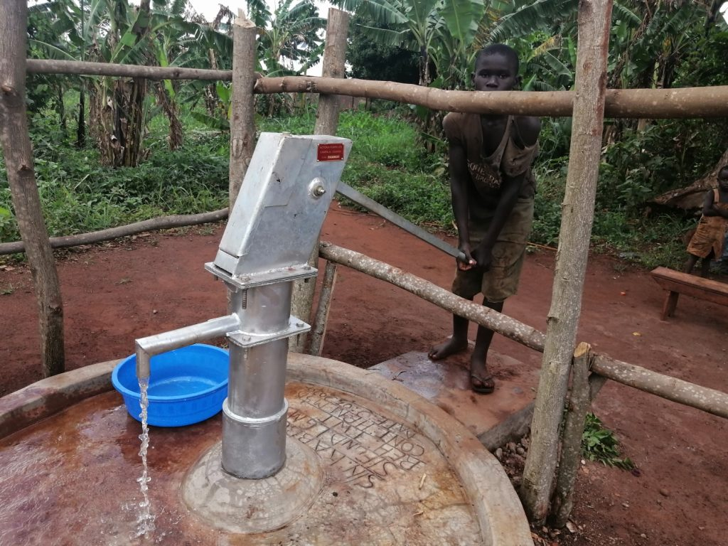 The Water Project : uganda20506-fetching-water-from-the-rehabilitated-well