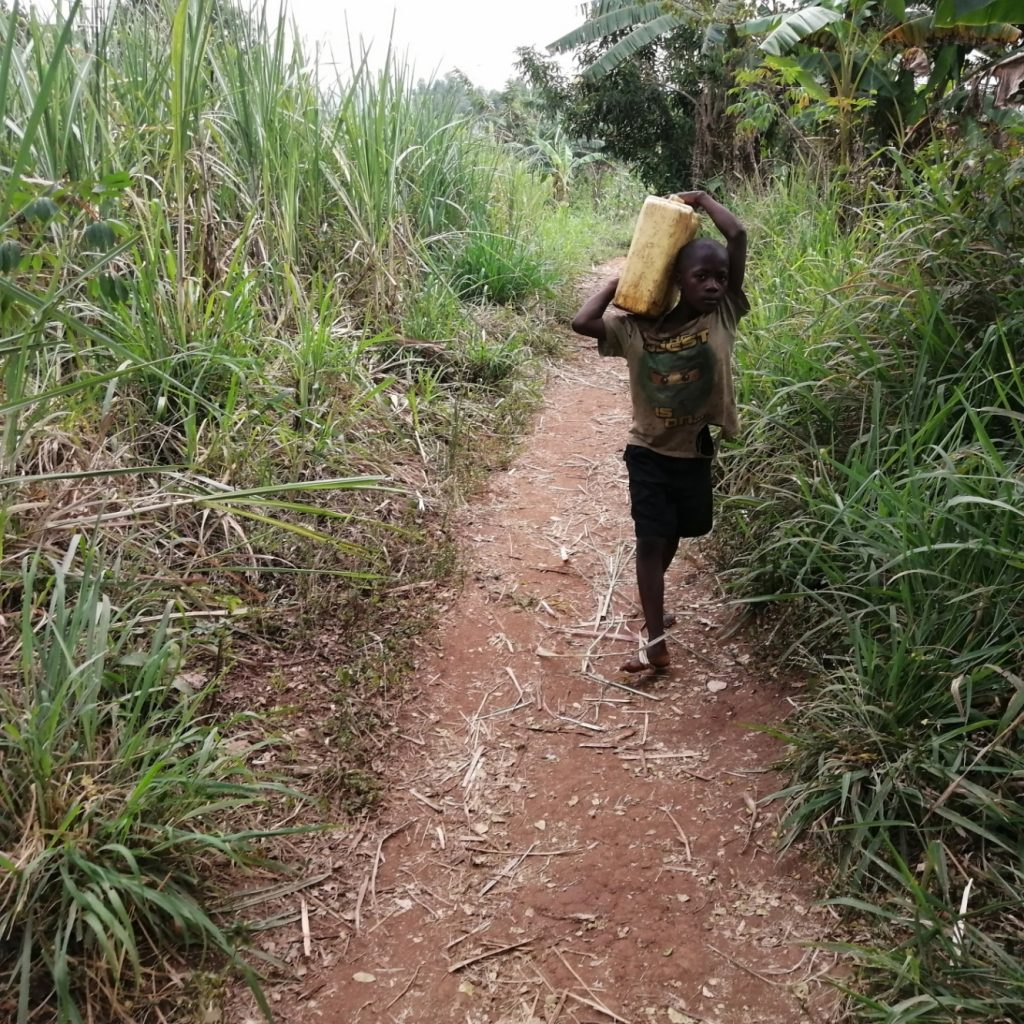 The Water Project : uganda21601-children-carrying-water-2