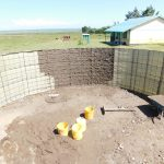 The Water Project: Eshimuli Primary School -  Plastering Inside Of The Tank
