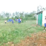 The Water Project: Eshimuli Primary School -  Students Carry Bricks To School
