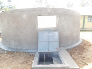 The Water Project:  Water Flowing From Finished Tank