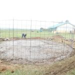 The Water Project: Eshimuli Primary School -  Fitting Wire To The Foundation