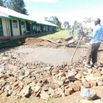 The Water Project: Eshimuli Primary School -  Laying Rain Tank Foundation