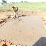 The Water Project: Eshimuli Primary School -  Pouring Latrine Foundation