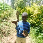 The Water Project: Shianda Township Community, Olingo Spring -  Bringing Materials To Spring Site