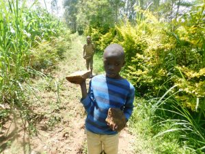 The Water Project:  Bringing Materials To Spring Site