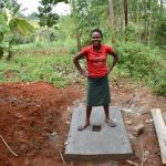 The Water Project: Machemo Community, Boaz Mukulo Spring -  Esther Posing On A New Sanplat