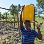 The Water Project: Machemo Community, Boaz Mukulo Spring -  Woman Carrying Water