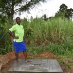 The Water Project: Kimang'eti Community, Kimang'eti Spring -  Redempta Poses On Her New Sanitation Platform