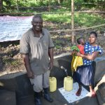 The Water Project: Shianda Township Community, Olingo Spring -  Multitasking Mothers Have Easier Access To Spring With Stairs