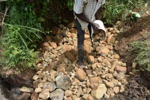 The Water Project:  Layering Smaller Stones
