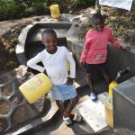 The Water Project: Shianda Township Community, Olingo Spring -  Collecting Water Is Now Fast And Fun