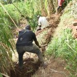 The Water Project: Musango Commnuity, Wabuti Spring -  Constructing Cutoff Drainage Channel Above Spring