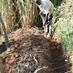 The Water Project: Musango Commnuity, Wabuti Spring -  Digging A Diversion Channel