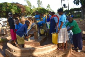 The Water Project:  Pupils Collect Water As Community Members Wait