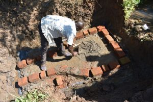 The Water Project:  Bricklaying Begins On Top Of Foundation