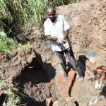 The Water Project: Musango Commnuity, Wabuti Spring -  Cutting Wire For Wall Reinforcement
