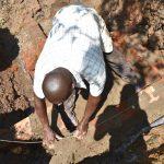 The Water Project: Musango Commnuity, Wabuti Spring -  Reignforcing Headwall Brickwork