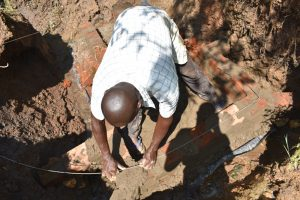 The Water Project:  Reignforcing Headwall Brickwork