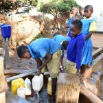 The Water Project: Ibokolo Primary School -  Collecting Water