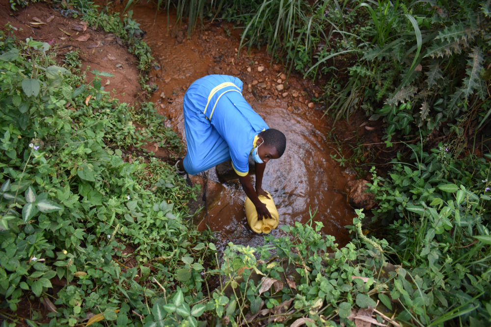 The Water Project : 3-kenya21214-fetching-water-from-an-open-source-9