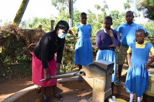 The Water Project:  Teacher Helps Pupils Fetch Water