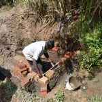 The Water Project: Musango Commnuity, Wabuti Spring -  Constructing The Headwall