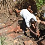 The Water Project: Musango Commnuity, Wabuti Spring -  Constructing Headwall And Wing Walls
