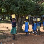 The Water Project: Ibokolo Primary School -  Carrying Water