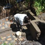 The Water Project: Musango Commnuity, Wabuti Spring -  Plastering The Walls