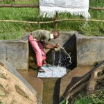See the Impact of Clean Water - Kalenda A Community, Webo Simali Spring