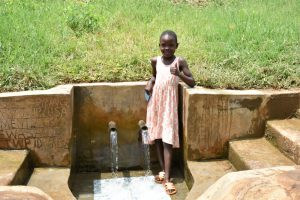 The Water Project:  Precious Gives Thumbs Up At The Spring