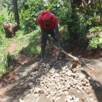 The Water Project: Shihome Community, Peter Majoni Spring -  Mixing Concrete