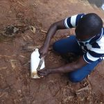 The Water Project: Shihome Community, Peter Majoni Spring -  Training On How To Make A Leaky Tin
