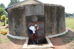 The Water Project:  Eupert Using The Rain Tank
