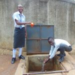 The Water Project: Ebubere Mixed Secondary School -  William And Another Student At The Rain Tank