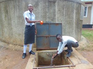 The Water Project:  William And Another Student At The Rain Tank