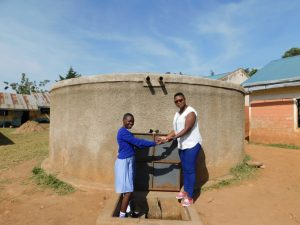 The Water Project:  Field Officer Jacklyne And Natasha Posing At The Tank