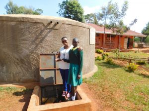 The Water Project:  Field Officerjacklyne With Nelson At The Rain Tank