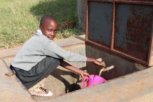 The Water Project:  Mitchelle Fetching Water From The Tank For Use