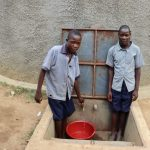 The Water Project: Matungu SDA Special School -  Derrick And A Friend Getting Water